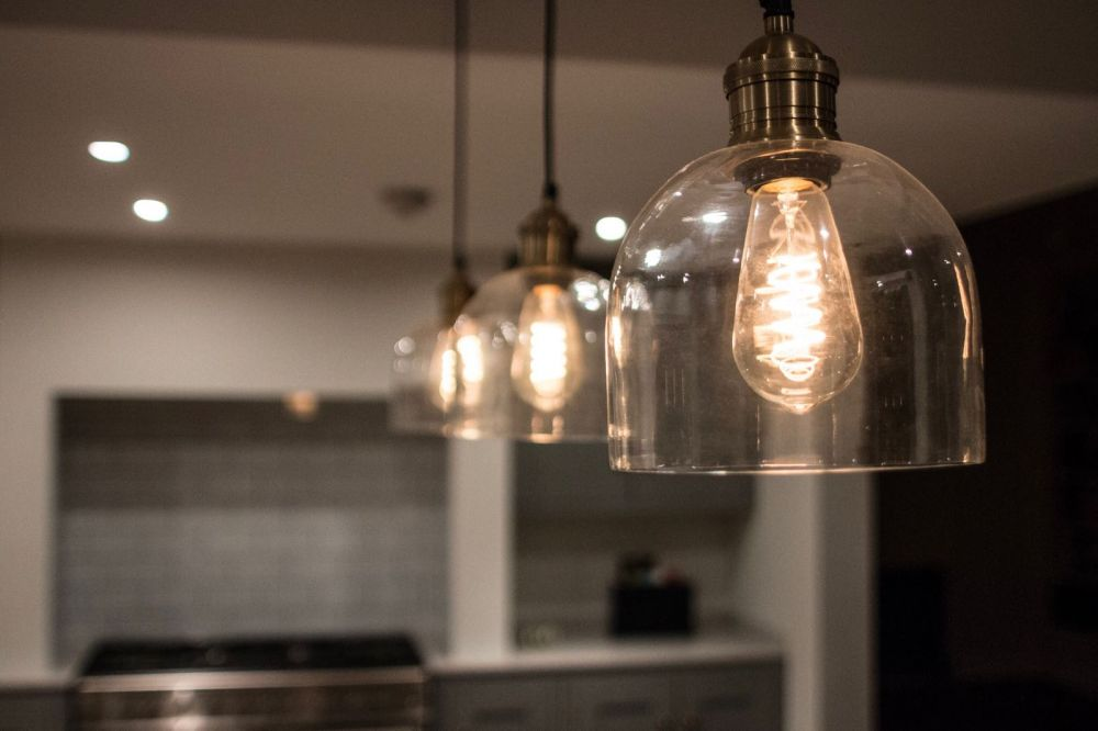 Glass Pendant LIghting with Squirrel Cage Bulbs over Inframe Island