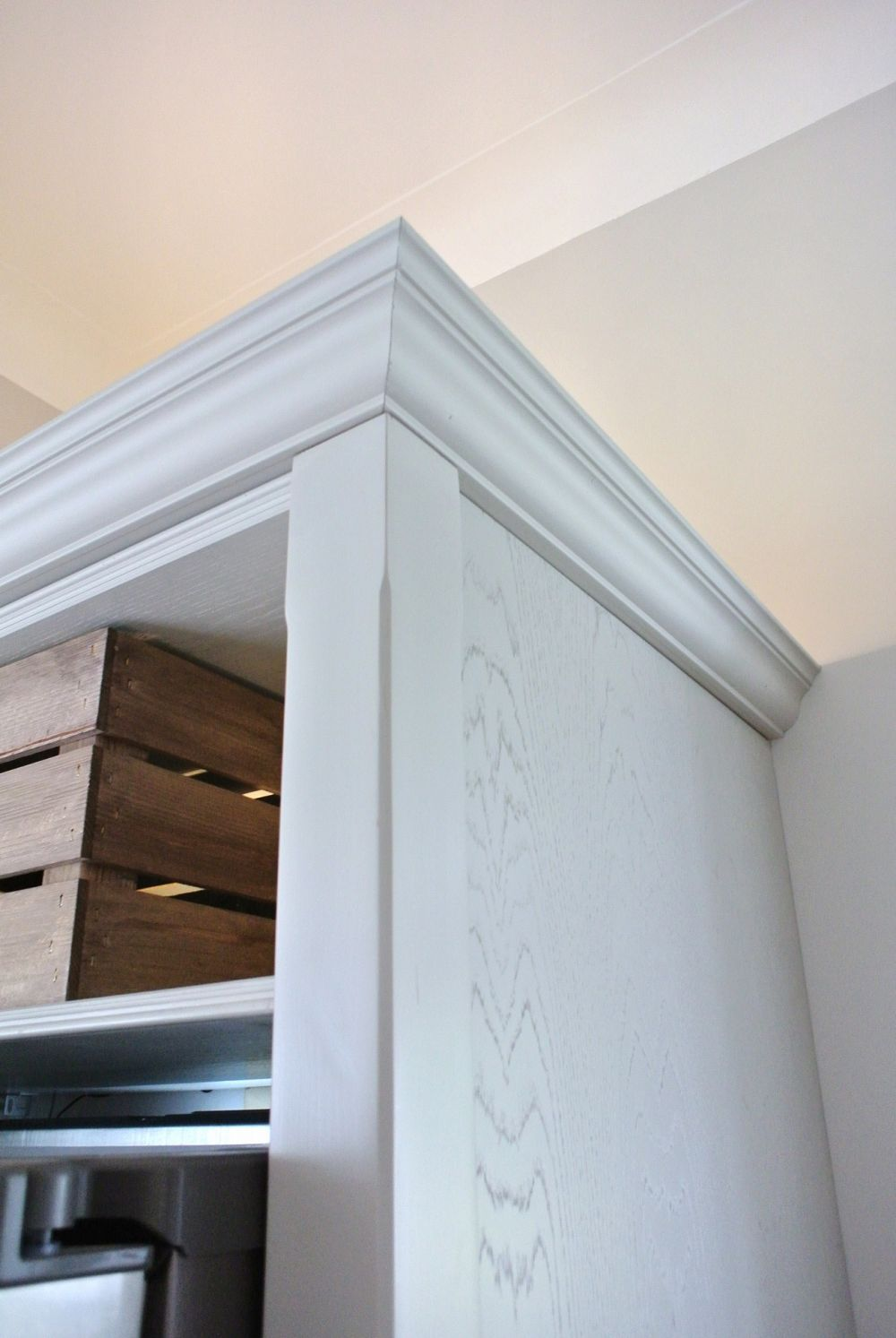Block painted newel with detail chamfer, stunning Oak grain panel with crown mould cornice