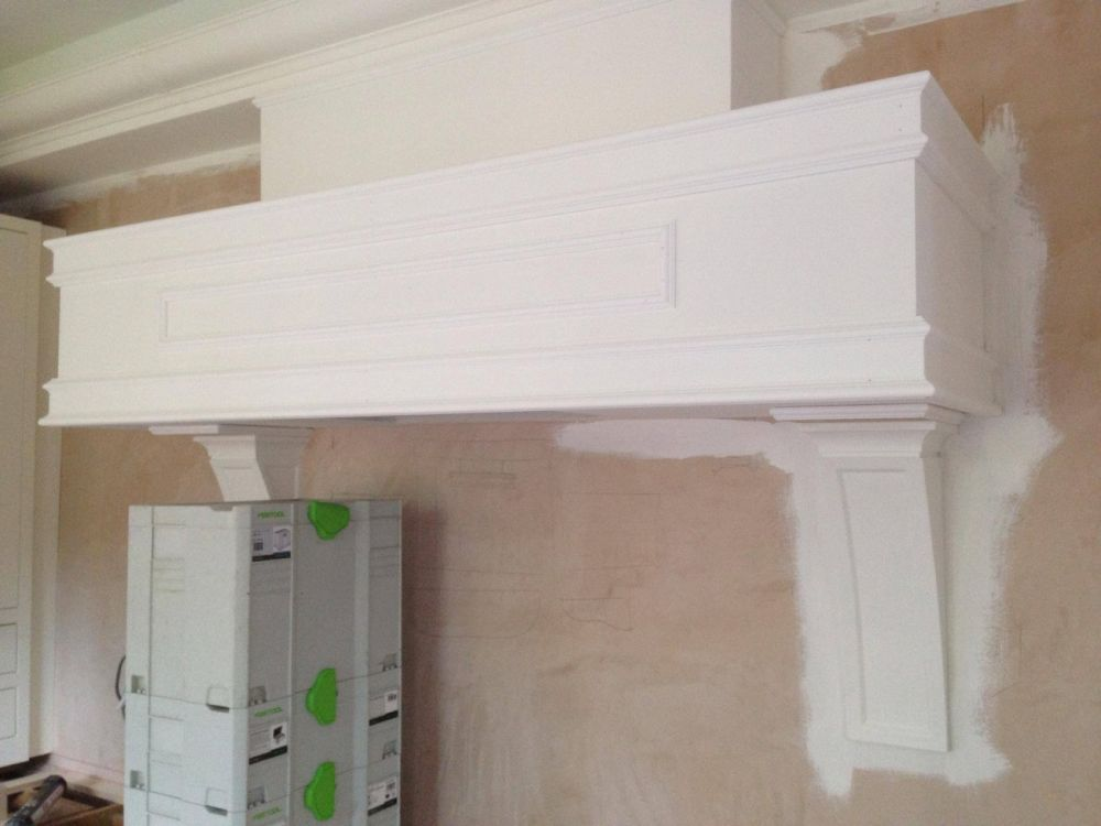 Bespoke floating mantle with large detail corbels, made from Oak panels. Primed ready for final coat of Farrow & Ball James White (2010)