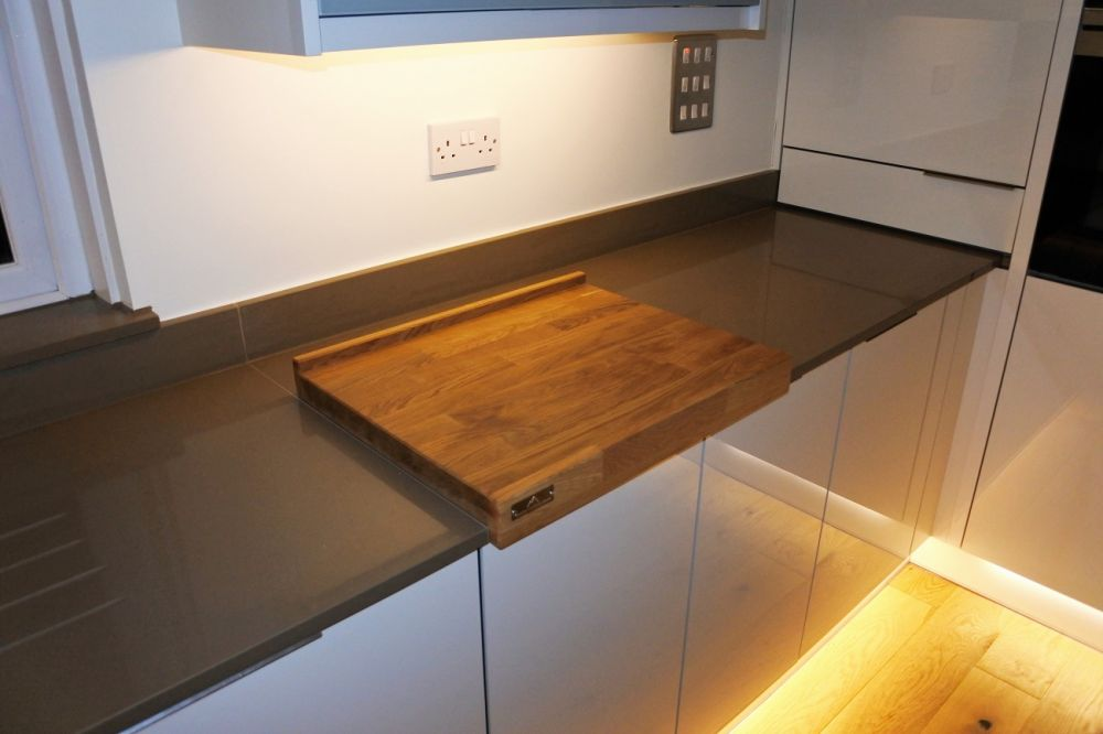 We can make you a stunning Oak reversible chopping board, you must protect that Silestone!