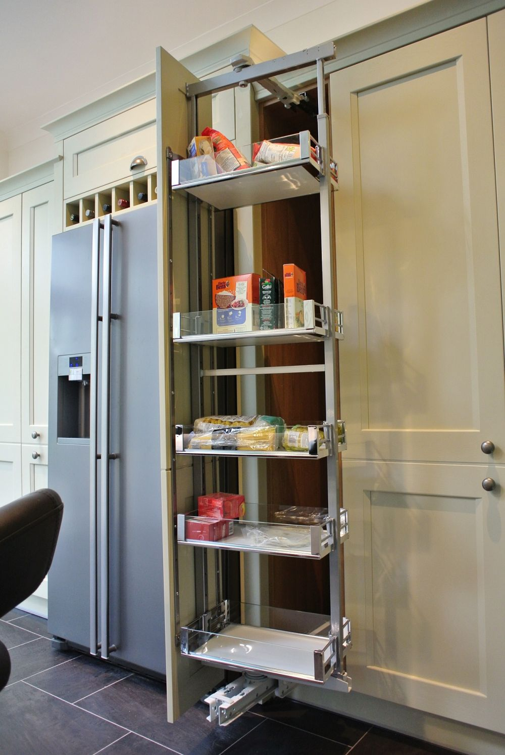 Rotating pull out larder. Pull towards you, push left or right, baskets spin 90 degrees for ease of access.