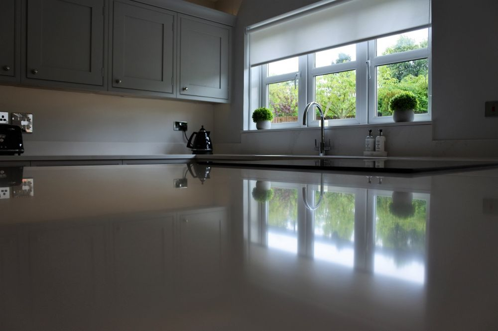 Calacatta gold silestone reflection with franke sink