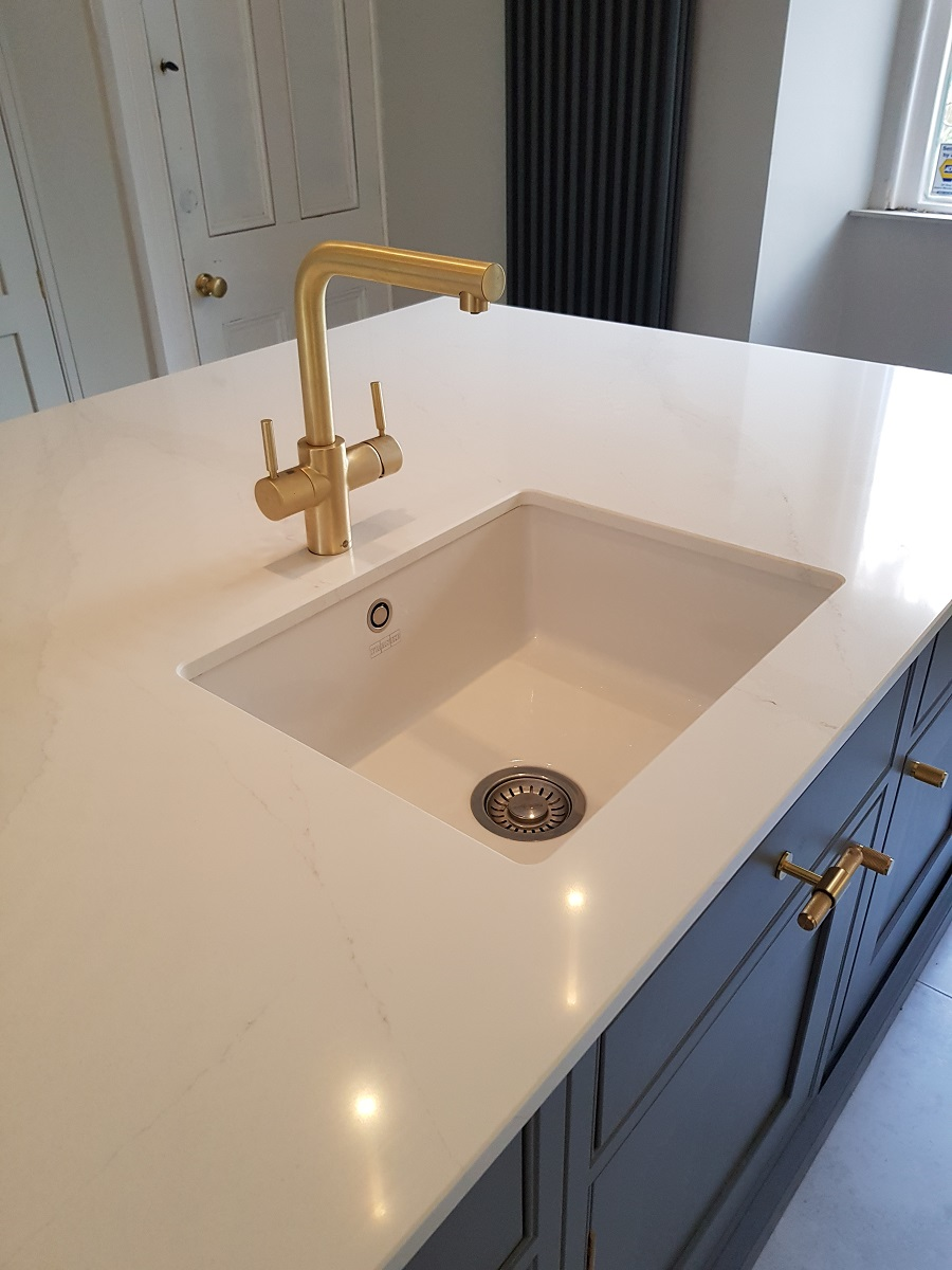 Inframe arundel franke ceramic undermount sink with gold 100 degree tap and calacatta gold silestone